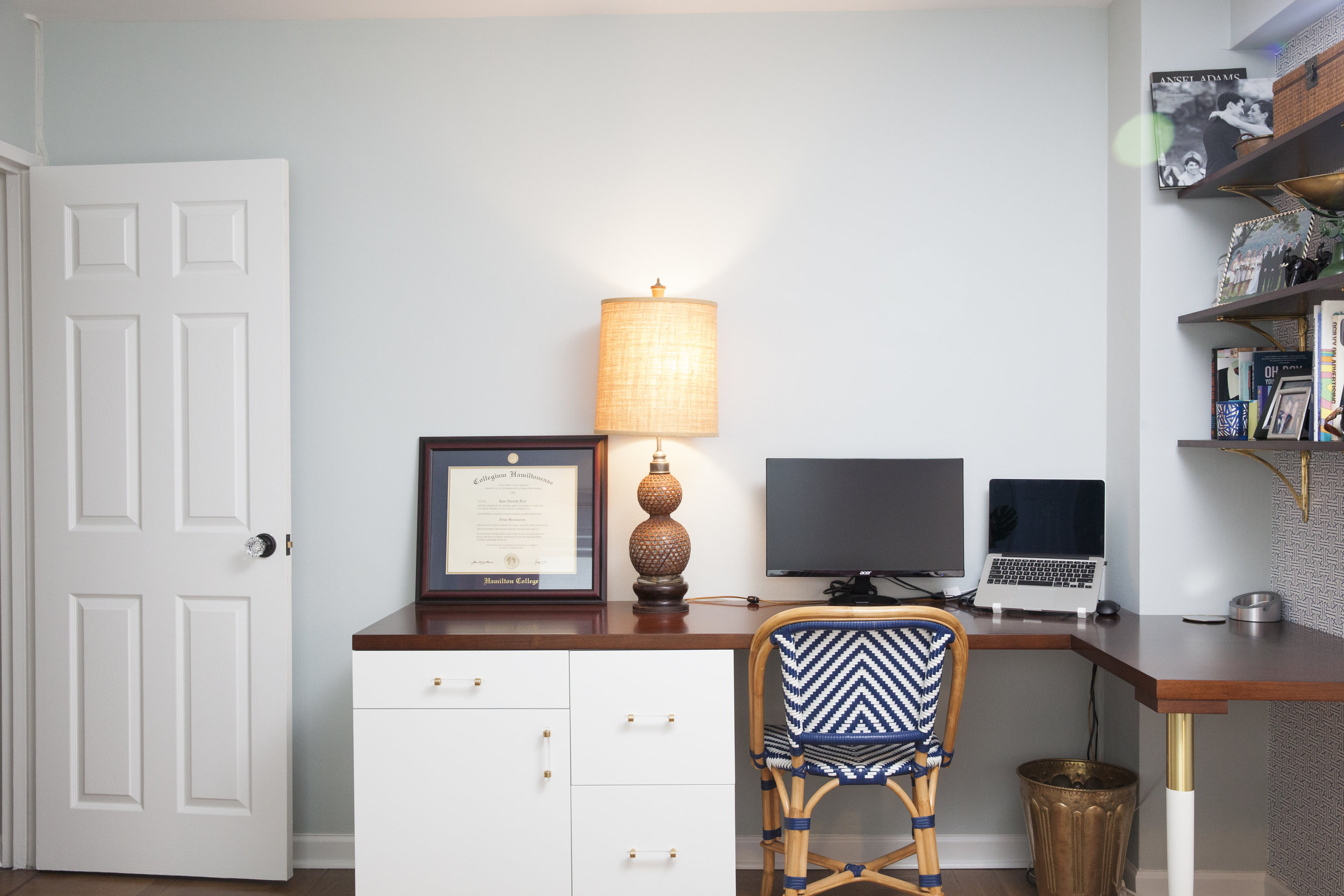 This custom desk was built to accommodate a corner soffit, as well as an outlet behind the cabinet. The client also had specific storage needs that we addressed when we customized the base - filing cabinet drawers, a small drawer for pens, pencils and other small items, and then a base to hold all the cable and internet equipment.