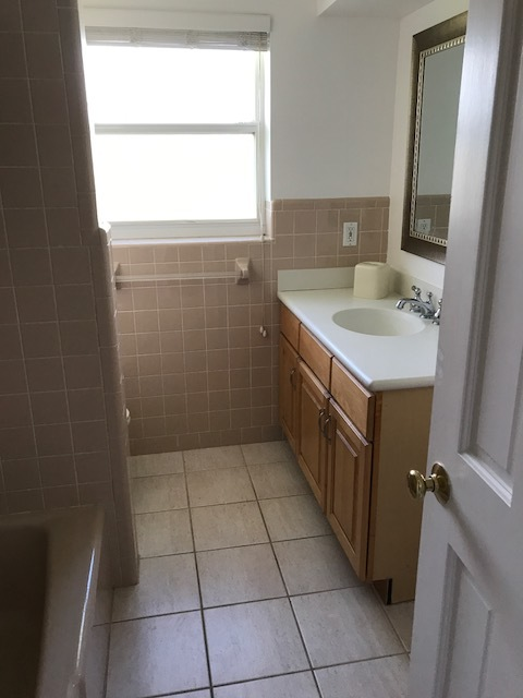 That pink tile is charming, but it's worn out it's welcome. We've got big plans for this guest bathroom.