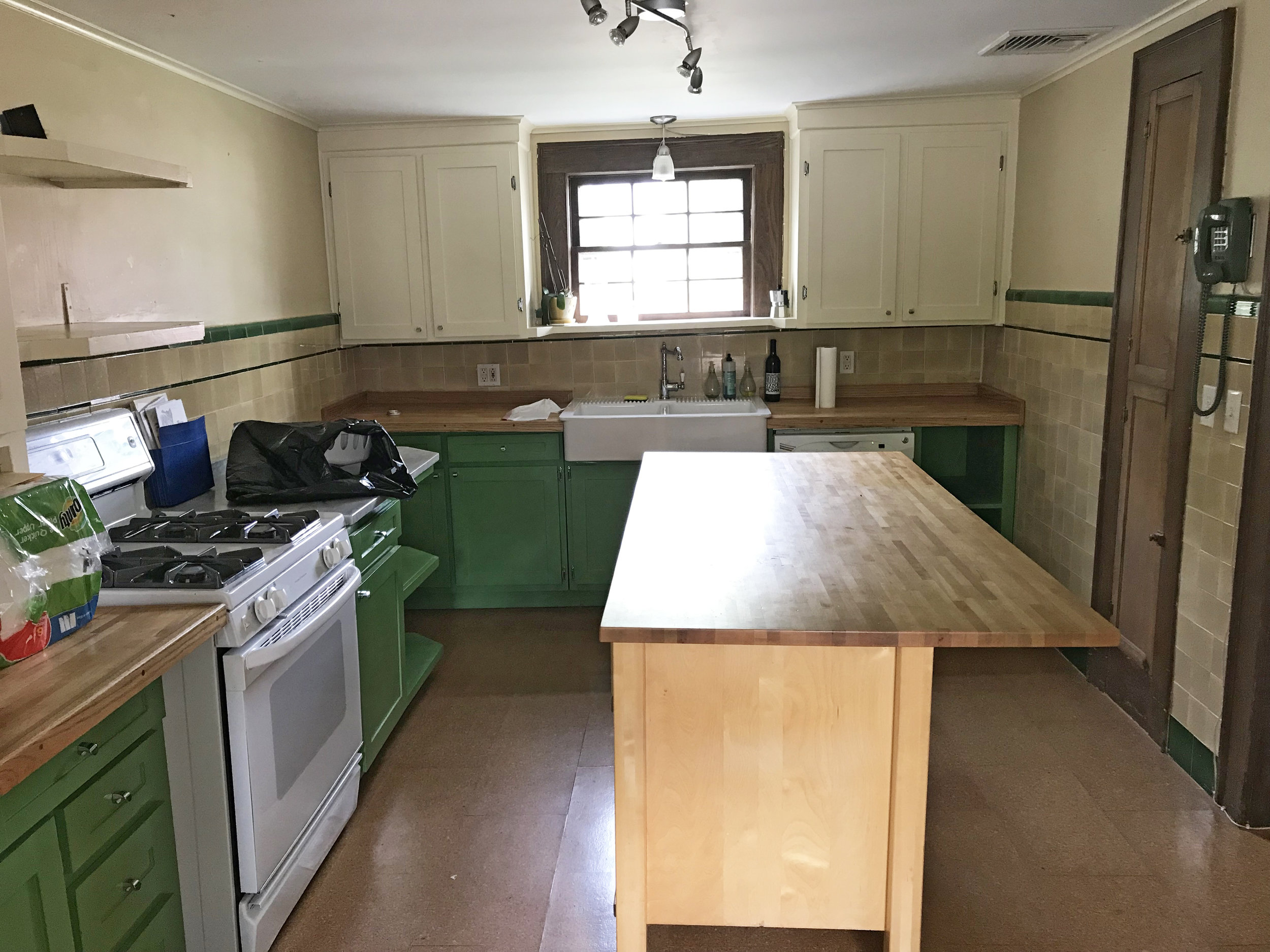 """This is getting a temporary facelift before a major overhaul. That angle you see on the back counter wall? That's really there,a 4"""" slope as the kitchen is falling off. Major. Renovation. Coming."""