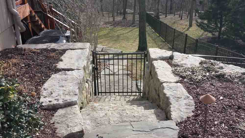 iron gate and fencing installation - bernies fence company.jpg