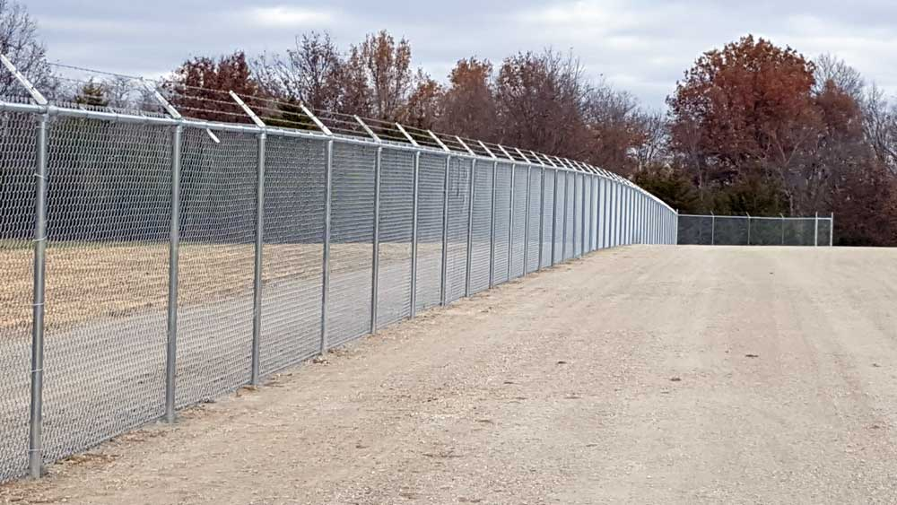 security-chain-link-with-bobwire-fencing---bernies-fence-company.jpg