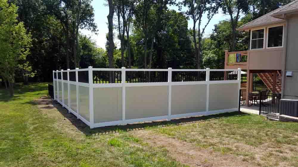 patio wood fence enclosure installation - call bernies fence company.jpg