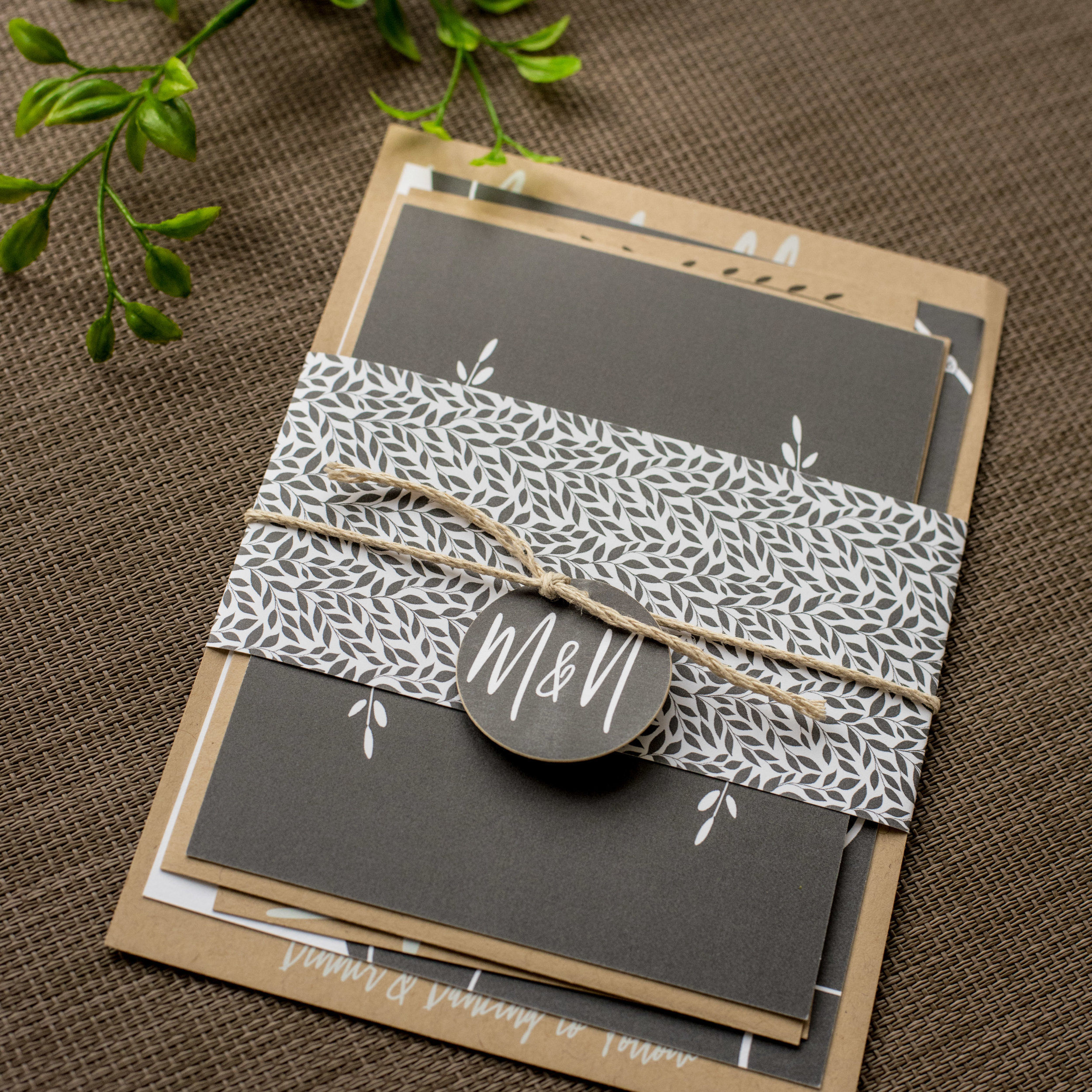 Industrial Chic Wedding Invitation by Ashley Parker Creative on Kraft Paper with Charcoal and Fern Accents, a Monogram Tag, and Printed Bellyband.  Full Assembly of Invitation.