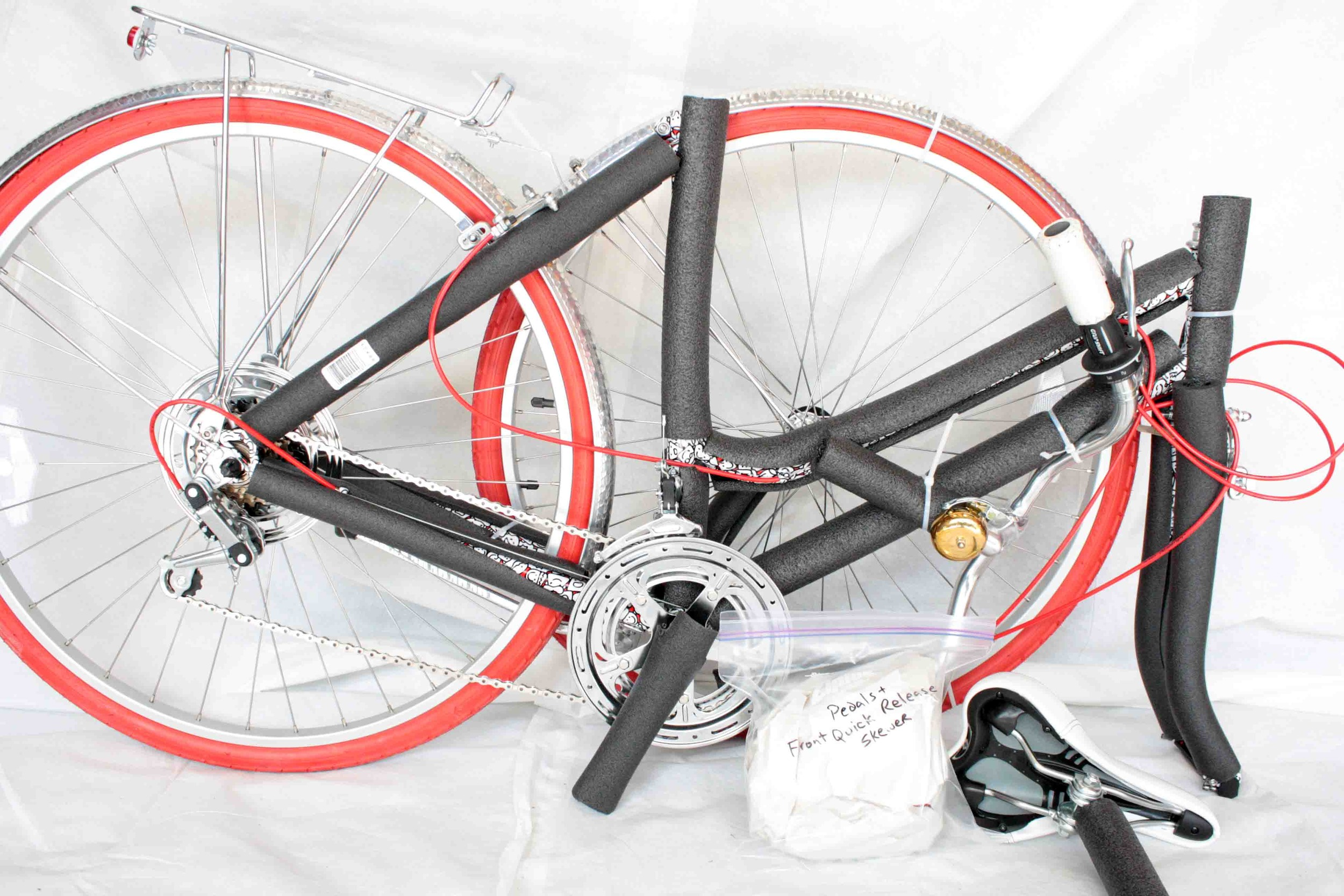 Set aside the bag containing the pedals and front quick release.