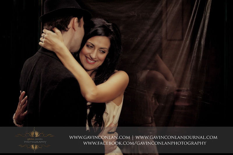 creative portrait of couple cuddling at Leadenhall Market. London engagement photography by  gavin conlan photography Ltd