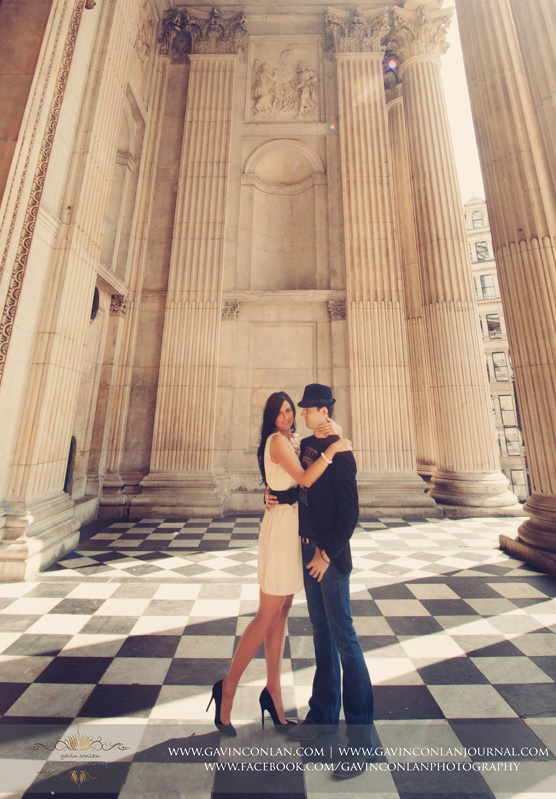 full length fashion portrait of the couple at St Pauls Cathedral. London engagement photography by  gavin conlan photography Ltd
