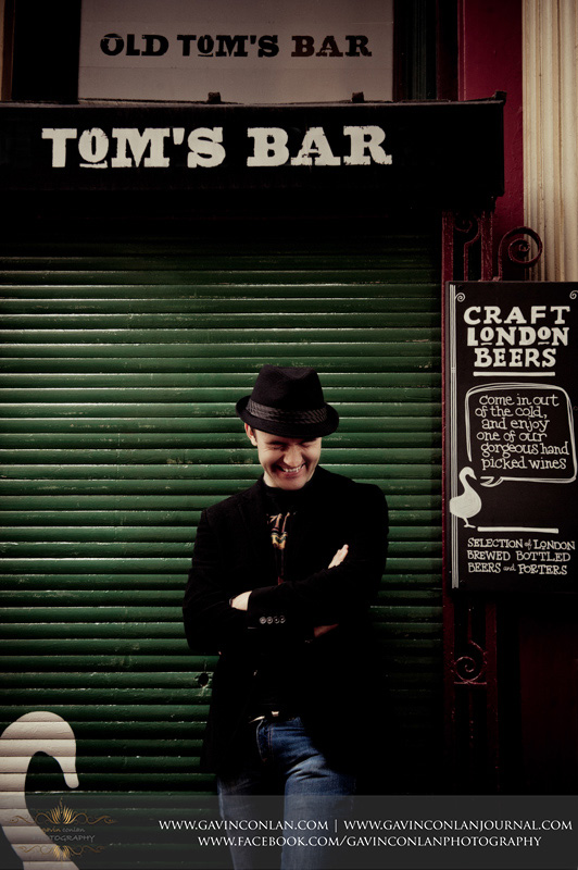 fun male portrait outside Toms Bar in Leadenhall Market. London engagement photography by  gavin conlan photography Ltd