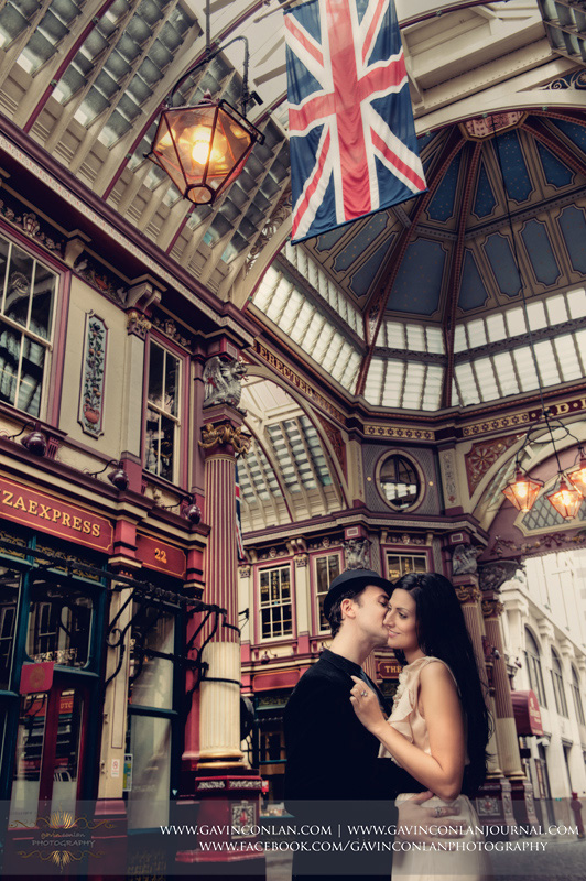 portrait of couple kissing in Leadenhall Market. London engagement photography by  gavin conlan photography Ltd