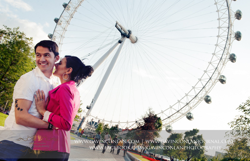 beautiful couple portrait outside the London Eye. London engagement photography by  gavin conlan photography Ltd