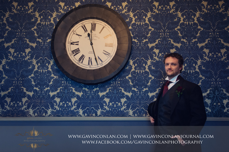 a classic portrait of the groom in the boys room.Wedding photography at Hengrave Hall by gavin conlan photography Ltd