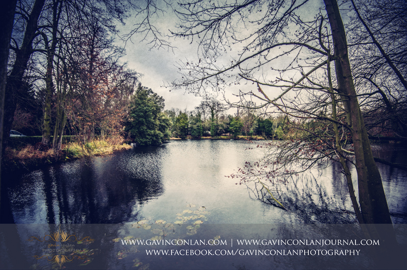 a classic landscape of the beautiful lake in the grounds of Hengrave Hall. Wedding photography at Hengrave Hall by gavin conlan photography Ltd