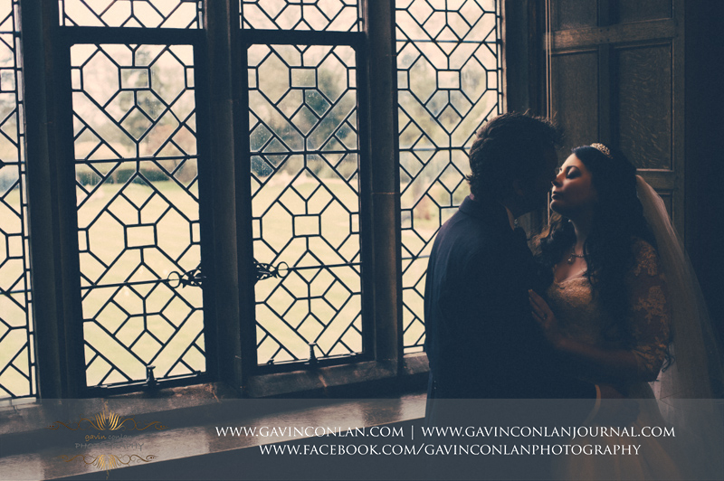creative portrait of the bride and groom.Wedding photography at Hengrave Hall by gavin conlan photography Ltd