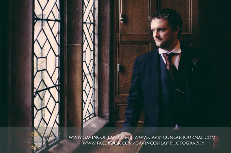 creative portrait of the groom.Wedding photography at Hengrave Hall by gavin conlan photography Ltd