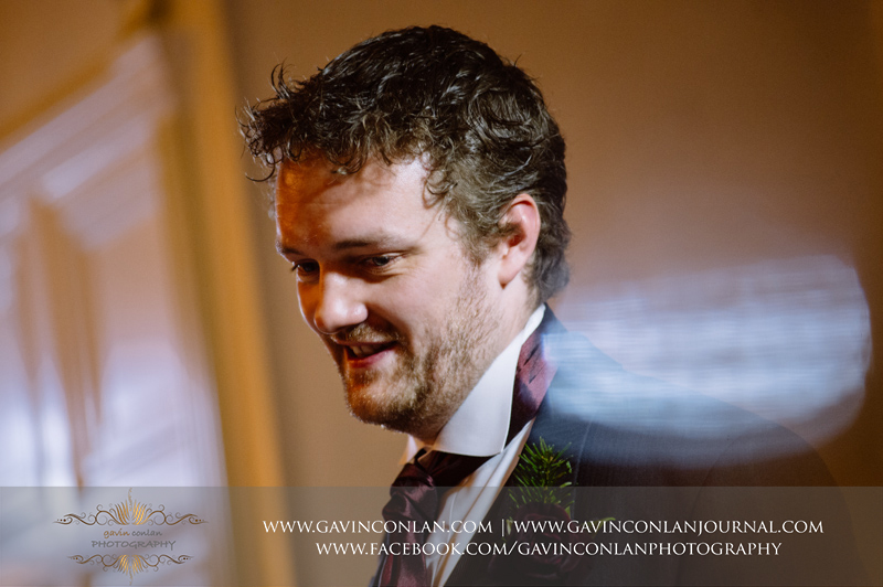 creative portrait of the groom during his speech. Wedding photography at Hengrave Hall by gavin conlan photography Ltd