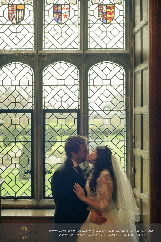 creative portrait of the bride and groom about to kiss each other.Wedding photography at Hengrave Hall by gavin conlan photography Ltd