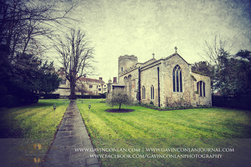 a beautiful landscape photo of the Church in the grounds of Hengrave Hall.Wedding photography at  Hengrave Hall  by  gavin conlan photography Ltd