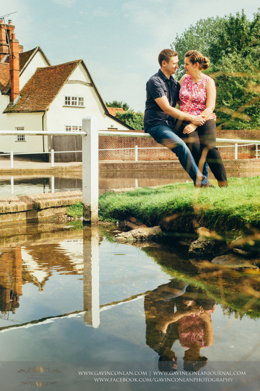 sarah and mark cuddling in Finchingfield.Essex engagement photography by gavin conlan photography Ltd