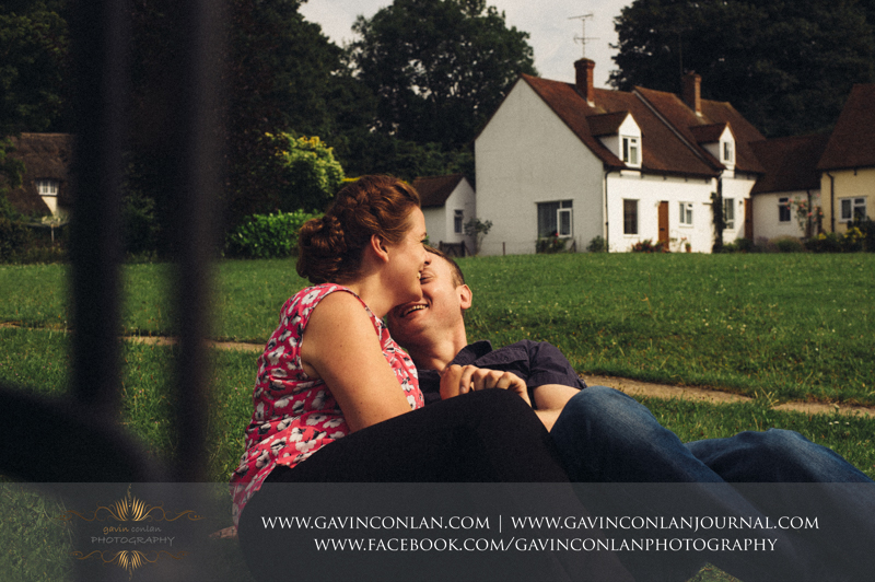 couple laughing in FInchingfield.  Essex engagement photography by  gavin conlan photography Ltd