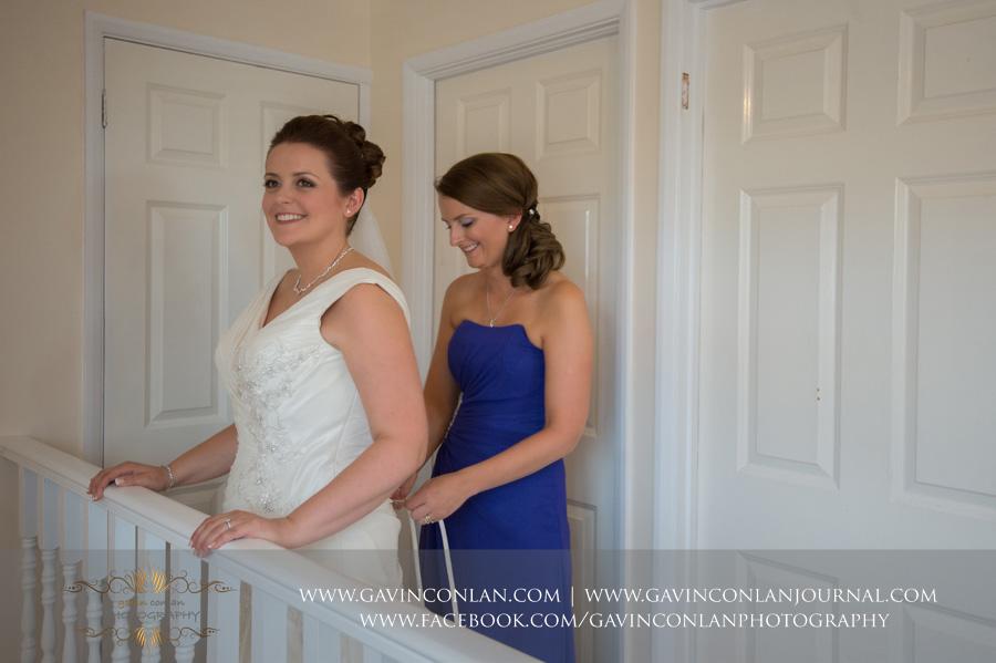 Bride getting dressed.Wedding photography by  gavin conlan photography Ltd