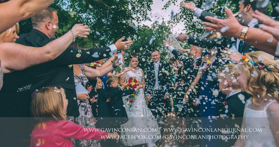 Confetti shot.Wedding photography at All Saints Cranham by gavin conlan photography Ltd