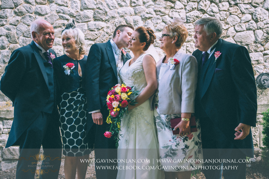 family portrait.Wedding photography at All Saints Cranham by gavin conlan photography Ltd