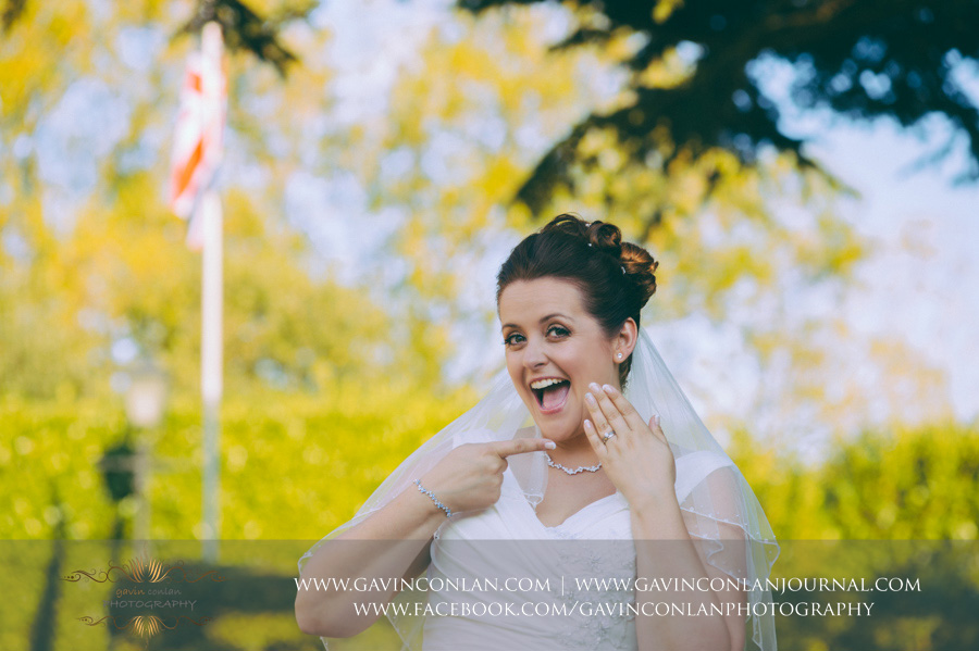 bride pointing at her wedding ring.Wedding photography at Moor Hall Venue by gavin conlan photography Ltd
