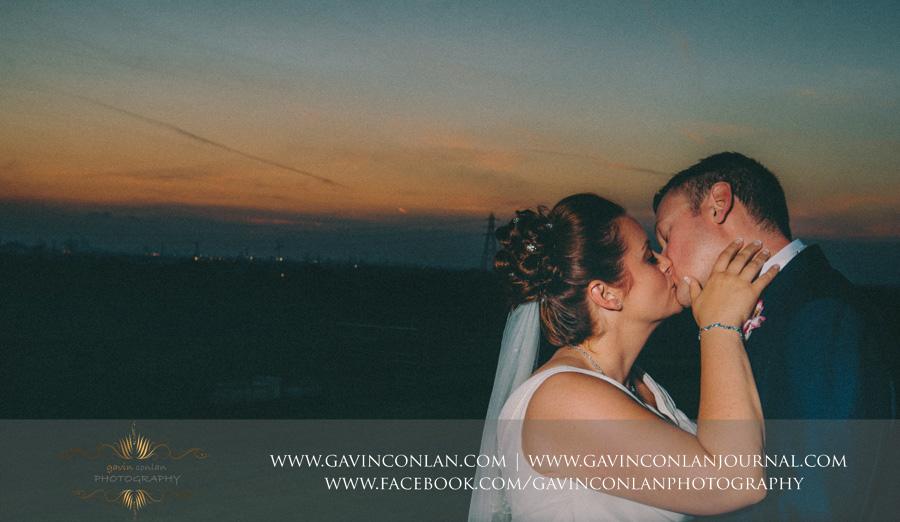 bride and groom kissing.Wedding photography at  Moor Hall Venue  by  gavin conlan photography Ltd