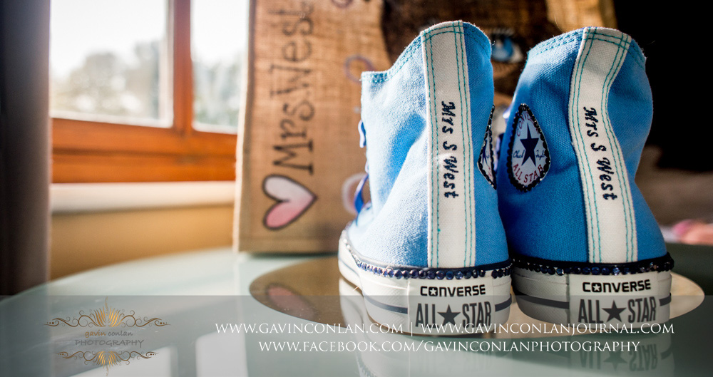 custom made converse that says Mrs S West - brides shoes detail photograph. Wedding photography at  The Essex Golf and Country Club  by  gavin conlan photography Ltd