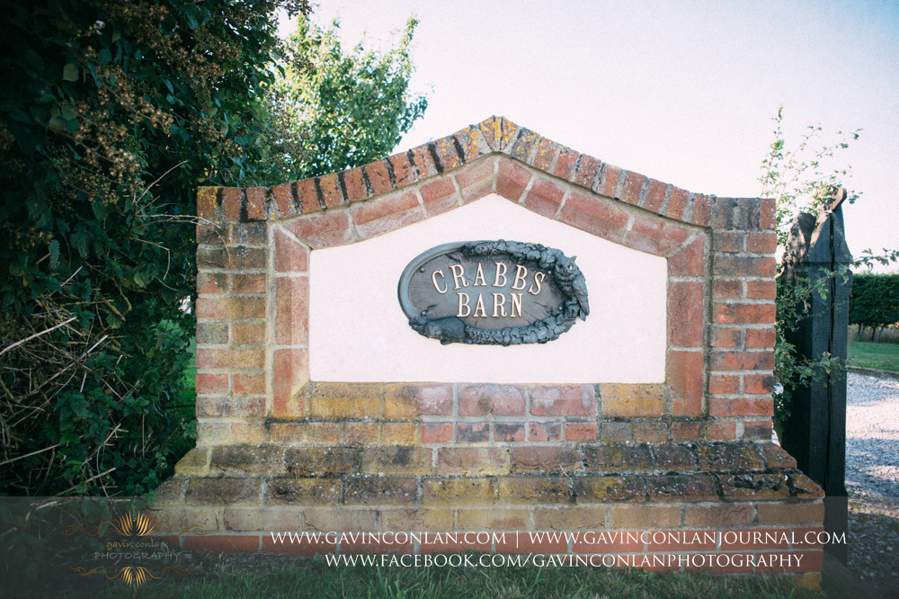 The entrance sign to Crabbs Barn. Wedding photography at  Crabbs Barn  by  gavin conlan photography Ltd