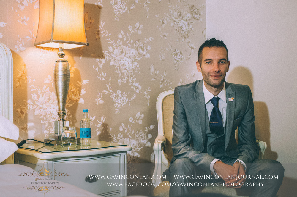 a portrait of the groom. Wedding photography at  Crabbs Barn  by  gavin conlan photography Ltd