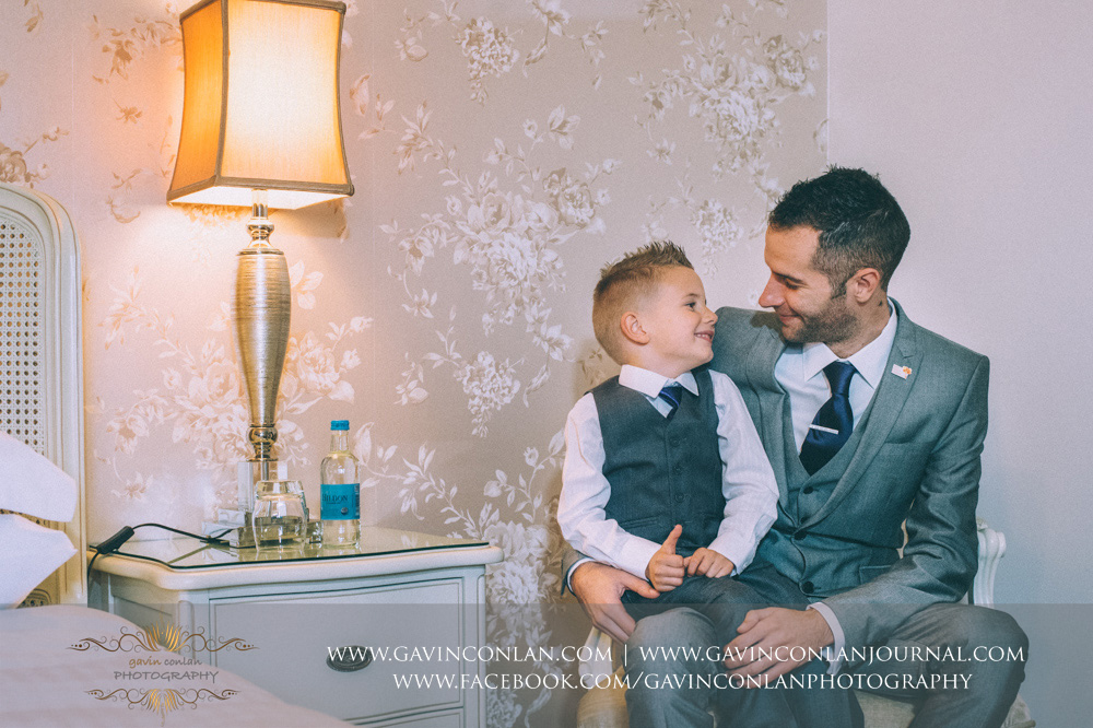 beautiful father and son portrait. Wedding photography at  Crabbs Barn  by  gavin conlan photography Ltd