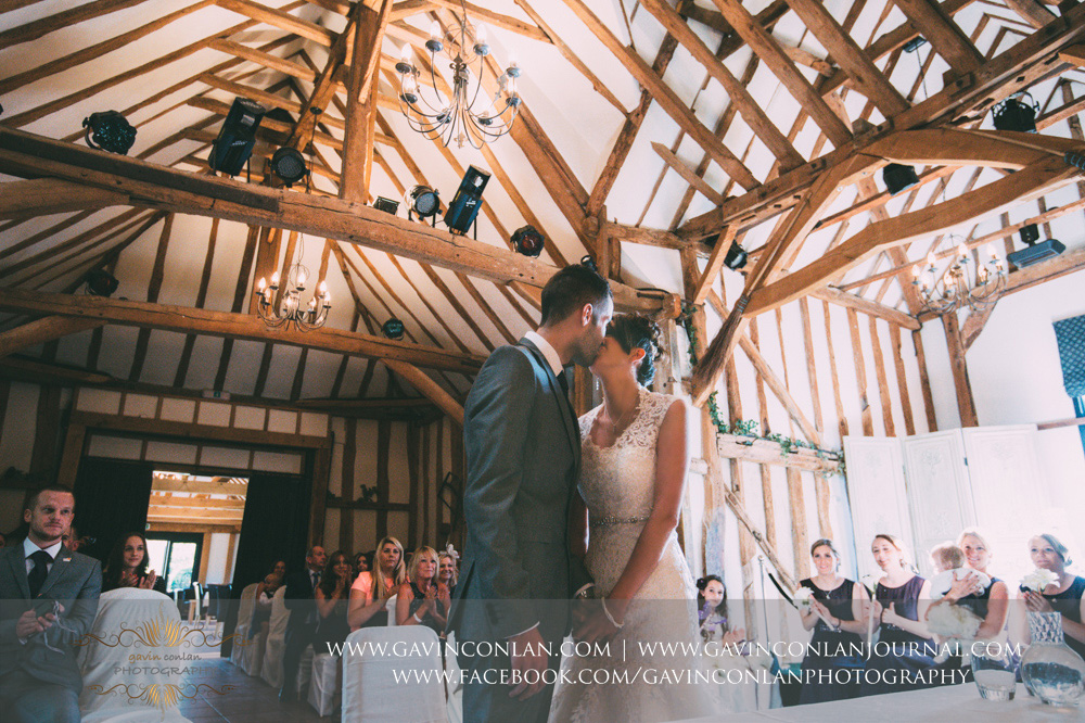 creative ceremony portrait of the bride and groom having their first kiss as a married couple. Wedding photography at  Crabbs Barn  by  gavin conlan photography Ltd