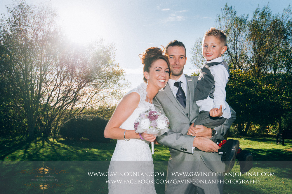 a beautiful family portrait of the bride, groom and their beautiful son. Wedding photography at  Crabbs Barn  by  gavin conlan photography Ltd