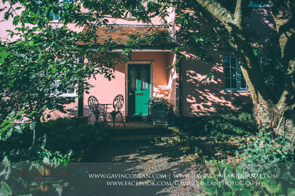 detail photograph of the house with the green door in the grounds of Crabbs Barn. Wedding photography at  Crabbs Barn  by  gavin conlan photography Ltd