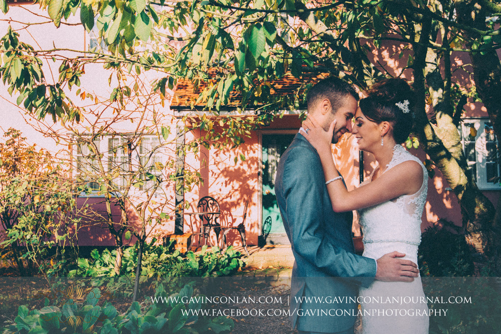 portrait of the bride and groom in the grounds of Crabbs Barn. Wedding photography at  Crabbs Barn  by  gavin conlan photography Ltd