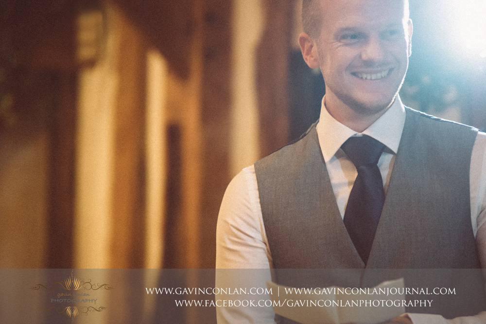 creative portrait of the best man during his speech. Wedding photography at  Crabbs Barn  by  gavin conlan photography Ltd