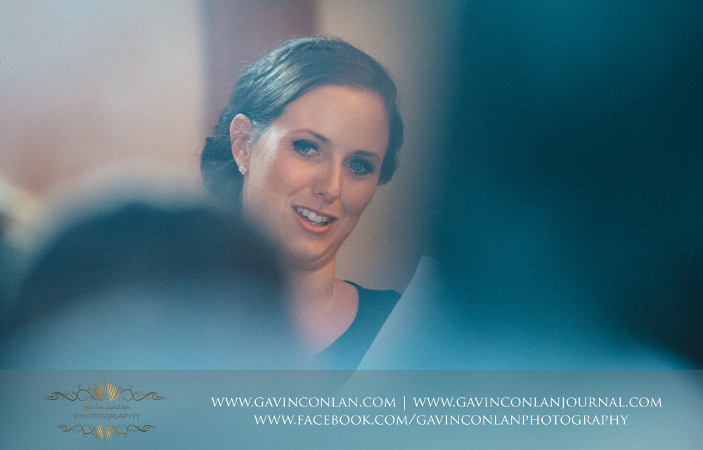 creative portrait of the maid of honour during her speech. Wedding photography at  Crabbs Barn  by  gavin conlan photography Ltd