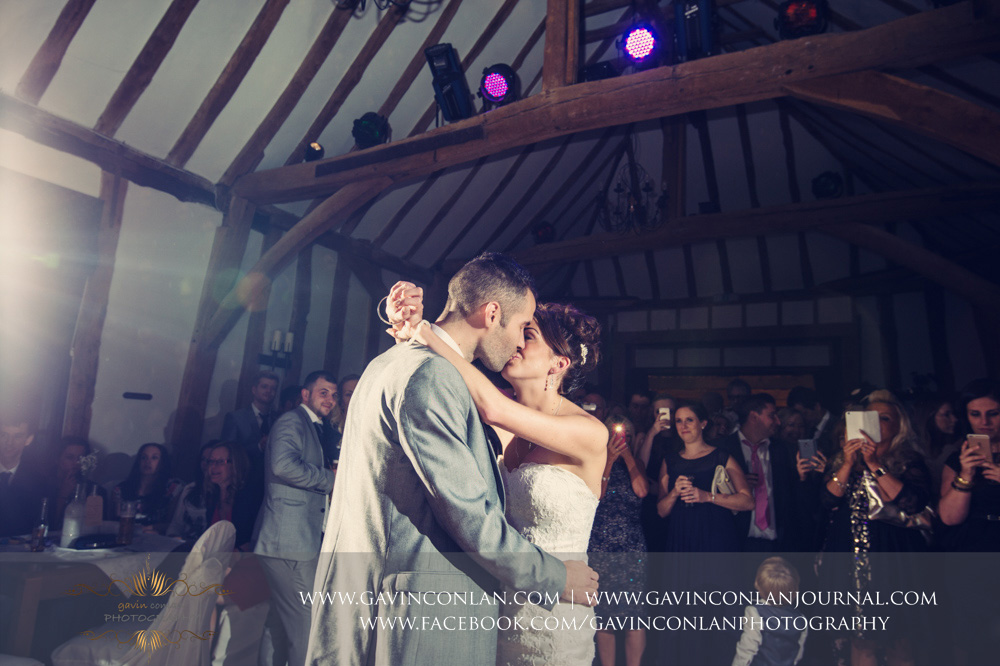 portrait of the bride and groom kissing during their first dance. Wedding photography at  Crabbs Barn  by  gavin conlan photography Ltd