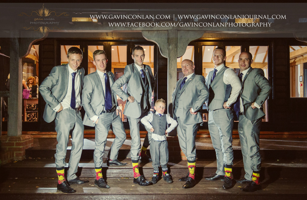 its all about the Iron Man Socks - fun with the boys doing their super hero poses. Wedding photography at  Crabbs Barn  by  gavin conlan photography Ltd