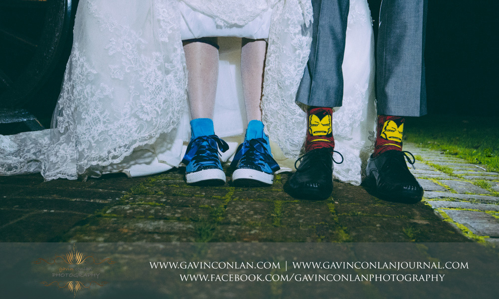 brides shoes vs grooms sock. Who will win the brides blue converse or the grooms iron man socks. Wedding photography at  Crabbs Barn  by  gavin conlan photography Ltd