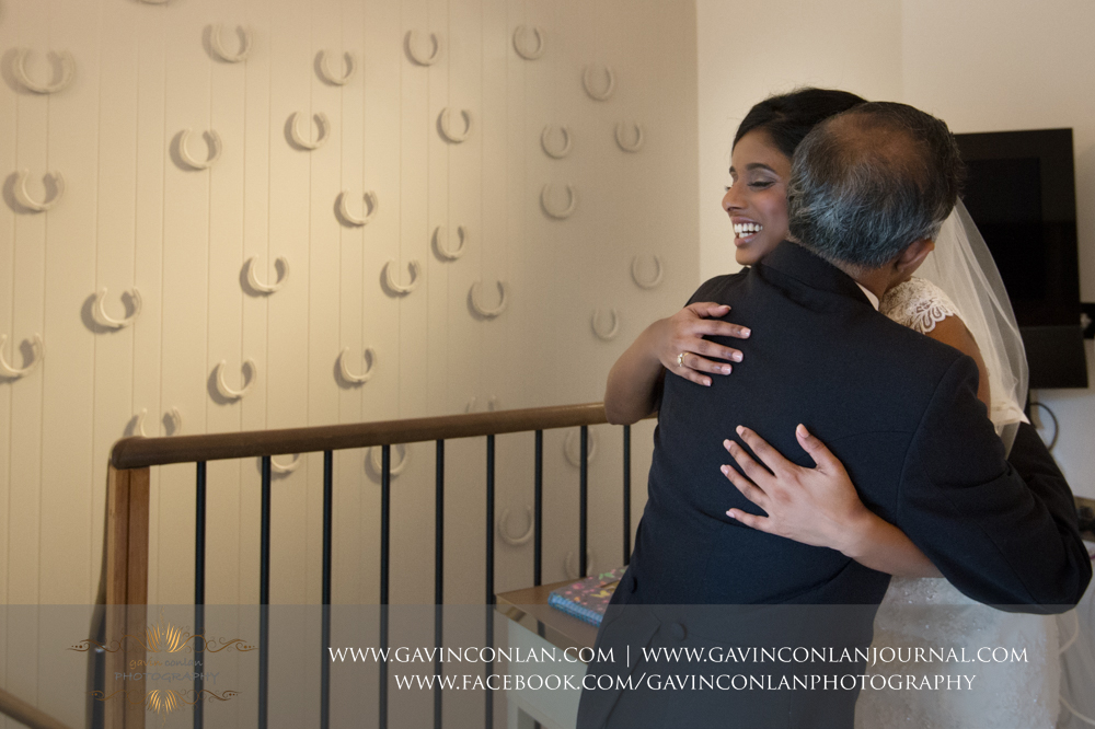 a beautiful embrace with father and daughter taken at  Coworth Park Hotel  by  gavin conlan photography Ltd