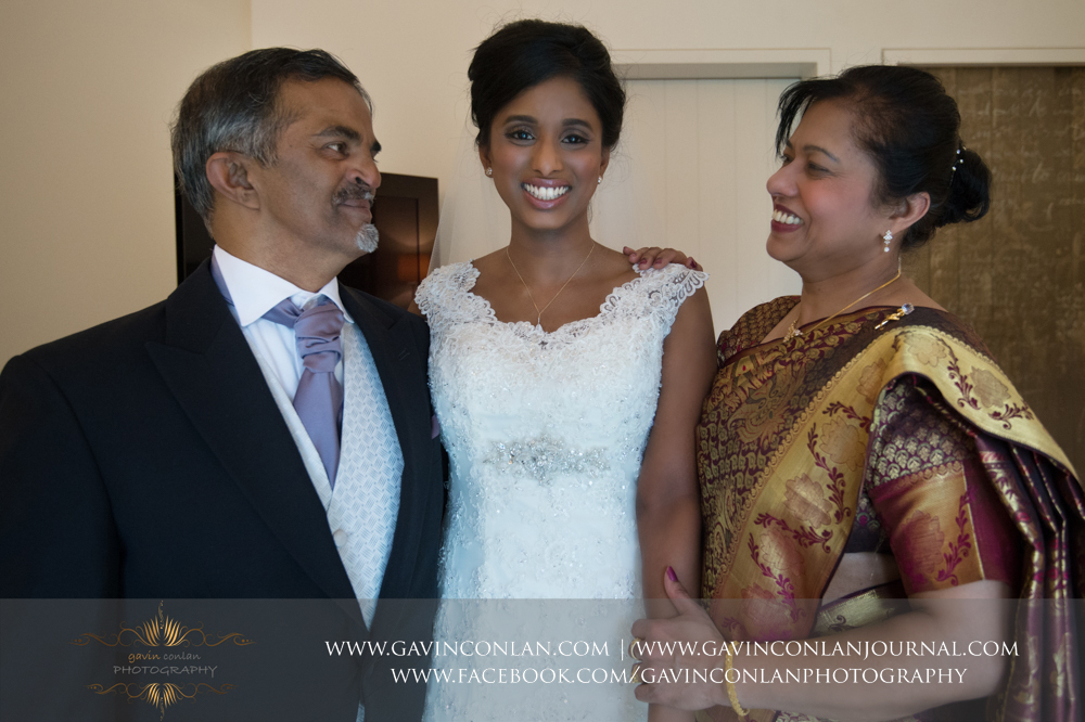 a stunning portrait of the bride and her parents at  Coworth Park Hotel  by  gavin conlan photography Ltd