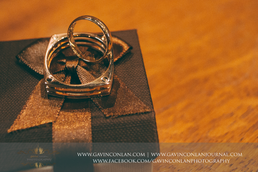 creative close up shot of the bride and grooms wedding rings at  All Saints Marlow  by  gavin conlan photography Ltd