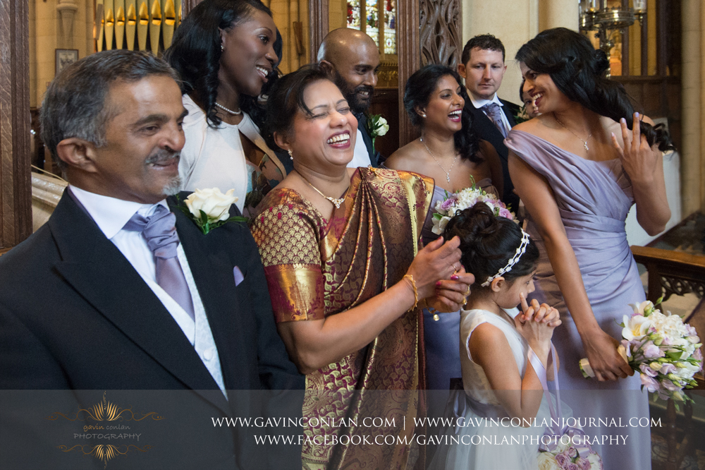 bridal party and family laughing together, wedding photography at  All Saints Church Marlow  by  gavin conlan photography Ltd