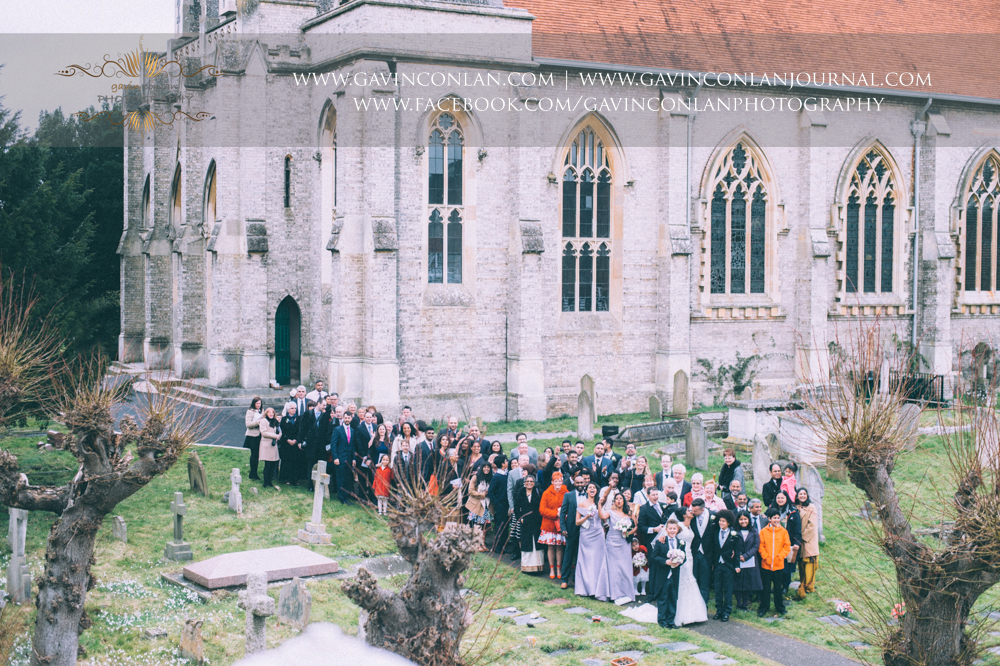 the iconic wedding group photography of the bride, groom and all their family and friends who attended the wedding, wedding photography at  All Saints Church Marlow  by  gavin conlan photography Ltd