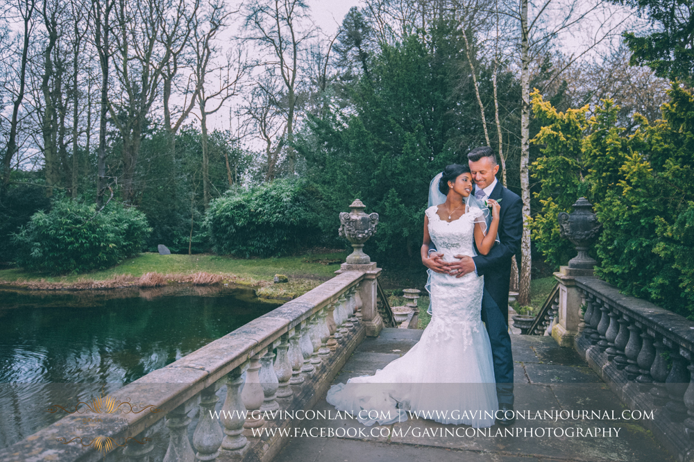 signature style bride and groom portrait on the stunning bridge, wedding photography at  Heatherden Hall Pinewood Studios  by  gavin conlan photography Ltd