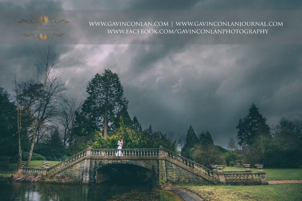 fine art signature style bride and groom portrait on the stunning bridge, wedding photography at  Heatherden Hall Pinewood Studios  by  gavin conlan photography Ltd