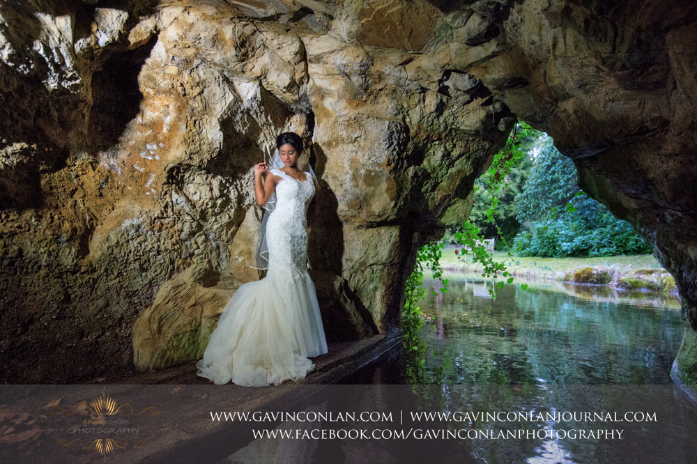 signature style bridal portrait in the amazing cave, wedding photography at  Heatherden Hall Pinewood Studios  by  gavin conlan photography Ltd