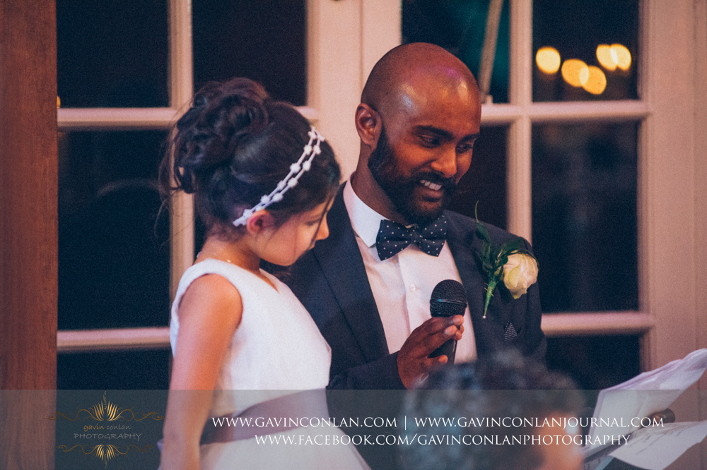 close up of the brother of the bride giving his speech, wedding photography at  Heatherden Hall Pinewood Studios  by  gavin conlan photography Ltd