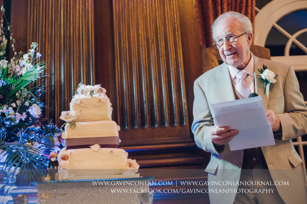 the father of the groom giving his speech, wedding photography at  Heatherden Hall Pinewood Studios  by  gavin conlan photography Ltd